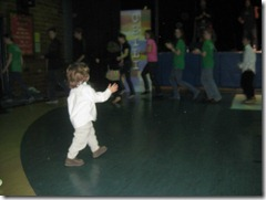ToddlerDancingClappingInKongaLine
